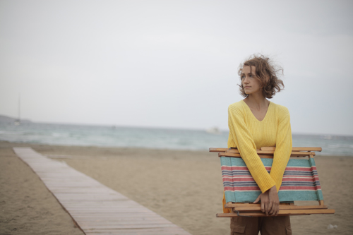 woman-on-beach-with-chair-small